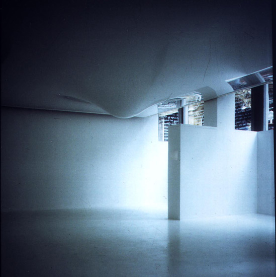 An immersive environment as critique of the concept of the white cube gallery space. The installation included alatex ceiling swollen with water (as if bearing down the weight of the Smithson Building above) windows covered in text and 2 videos of compromised white surfaces.