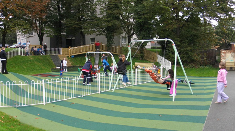 The sense of enclosure is disrupted by the patterned play surface that links both areas.