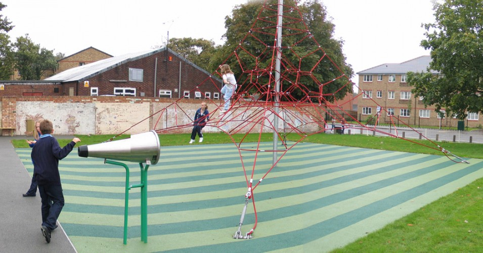 The scheme makes use of and enhances the undulating ground and the presence of existing mature trees. An enclosed area with play equipment is provided for younger children with a sheltered, lit seating area for teenagers.